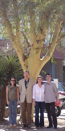 Photo of FeverLab members under a fever tree